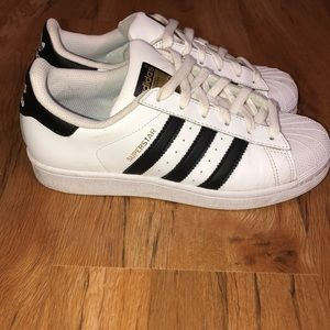 White and black shell toe adidas sneakers